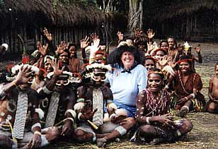 Dr Lillian Larson sitting with villagers in Indonesia