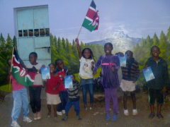 Kenyan school children jump for joy when they got their Falling Uphill books.