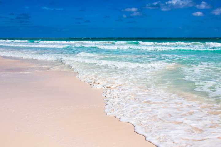 Bahamas. Pink sand beaches, turquoise sea and deep blue sky.